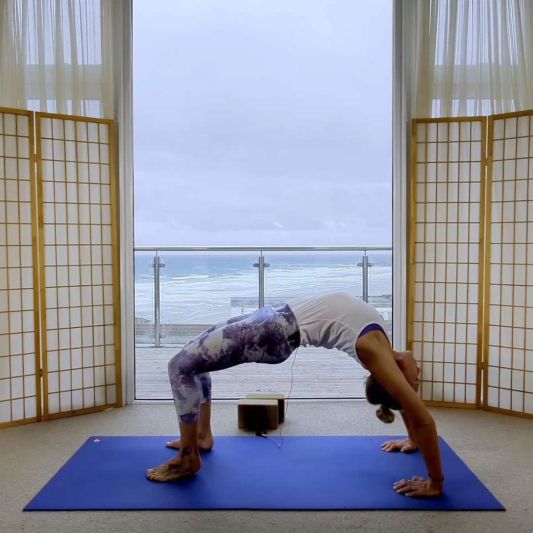 online on demand yoga classes uk flowing to full wheel